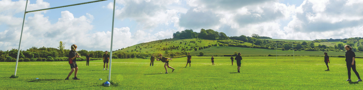 Pupils playing sports on the field
