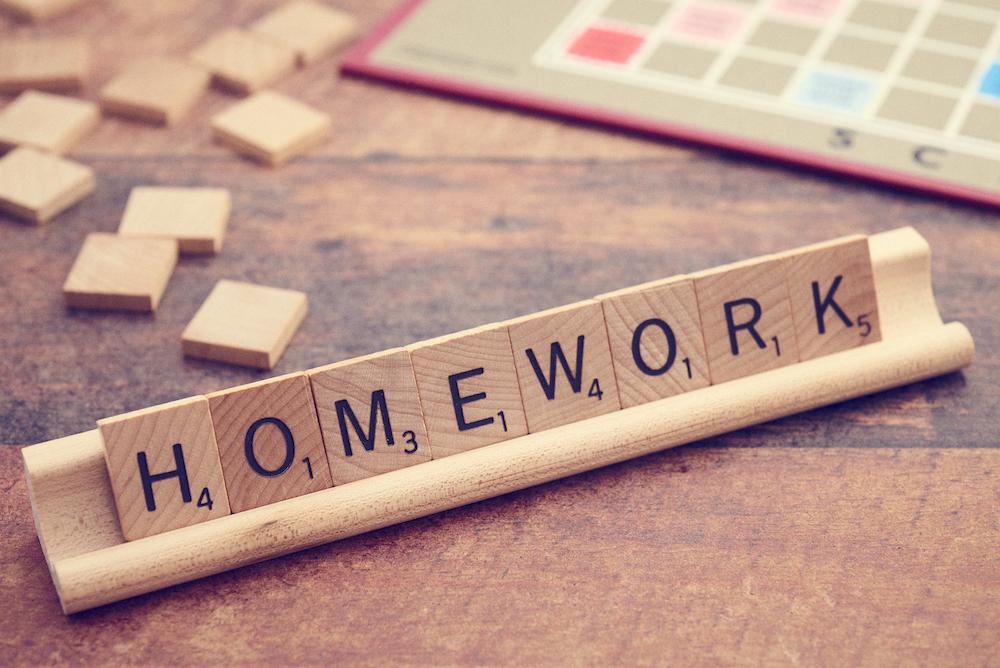 """Scrabble tiles spelling out """"homework"""""""